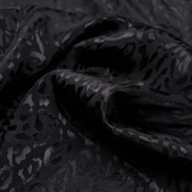 Tissu jacquard noir sergé à motif léopard satiné - pretty mercerie - mercerie en ligne