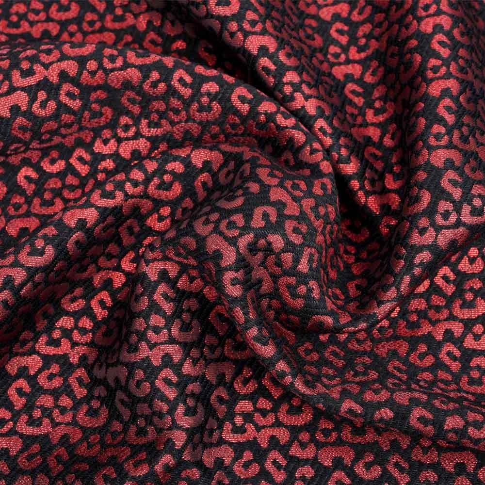Tissu jacquard noir à motif léopard fil lurex rouge   pretty mercerie   mercerie en ligne